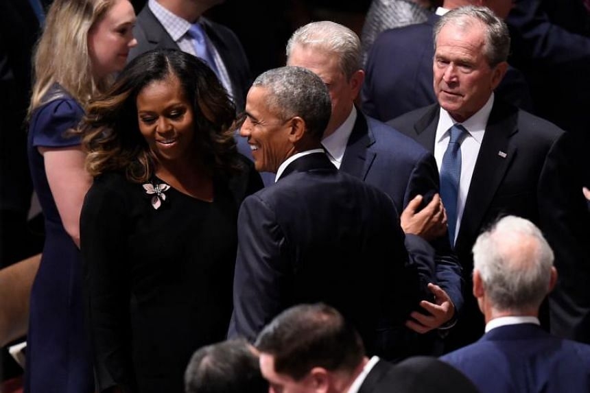 Former US presidents Barack Obama and George W. Bush arrive for the Memorial Service for US Senator John McCain at the Washington National Cathedral on Sept 1, 2018.