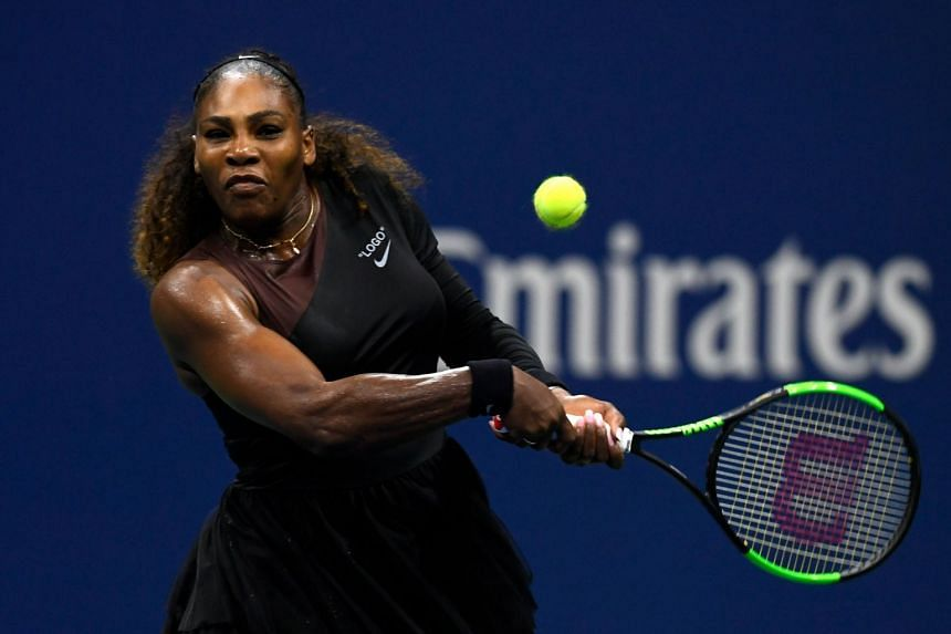 Serena Williams returns the ball during her US Open women's singles third round match against her sister Venus at the USTA Billie Jean King National Tennis Center in New York, on Aug 31, 2018.