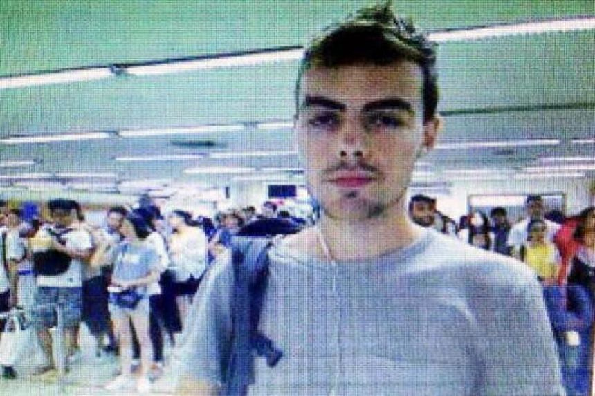 David James Roach, seen here in a screengrab image at Thai immigration, allegedly robbed a Standard Chartered Bank branch in Holland Village on July 7, 2016, then fled to Bangkok hours later.