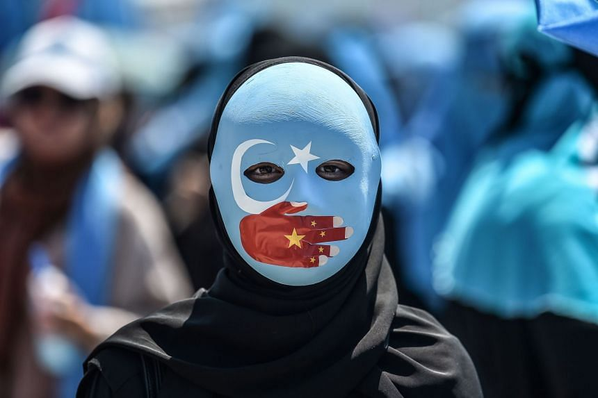 A demonstrator attends a protest to denounce China's treatment of ethnic Uighur Muslims during a deadly riot in July 2009 in Urumqi, in front of the Chinese consulate in Istanbul, on July 5, 2018.