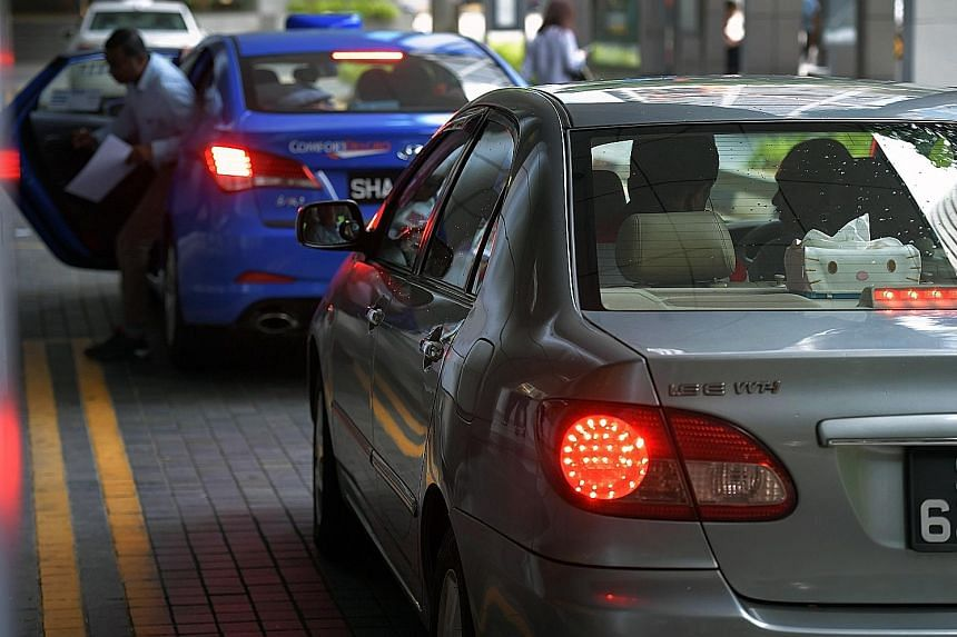 ComfortDelGro taxis charge a 10 per cent administrative fee for each ride paid for with a credit card.