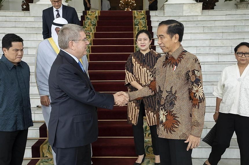 "Indonesia's President Joko Widodo with IOC chief Thomas Bach in Jakarta yesterday. Mr Joko says Indonesia plans ""to immediately register itself as a candidate for the 2032 Olympics host"", a surprise announcement which Mr Bach has welcomed."