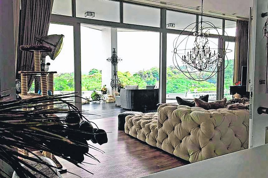 This living room photo taken two years ago, offers a view of the upmarket One Degree 15 Marina Club.