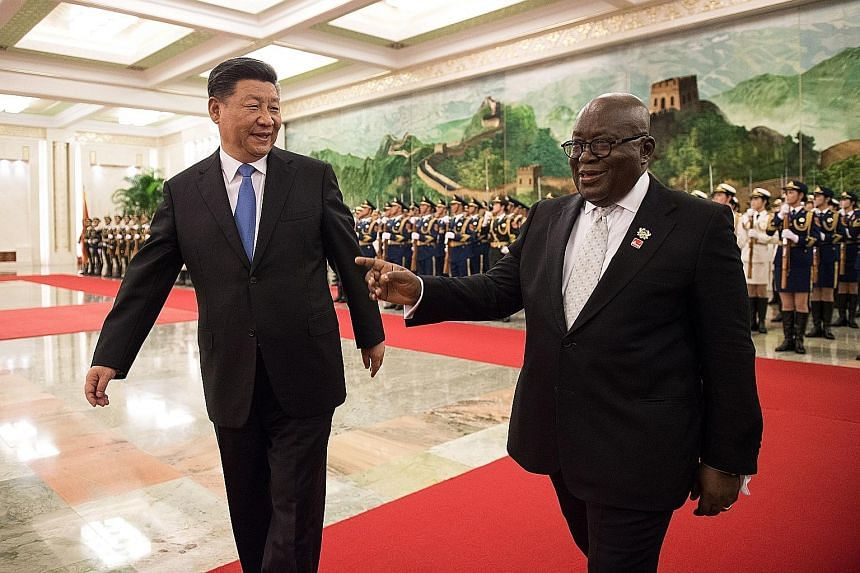China's President Xi Jinping and Ghana's President Nana Akufo-Addo at the Great Hall of the People in Beijing, China yesterday.