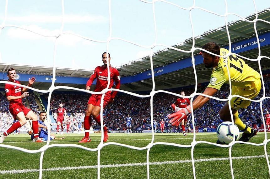 Leicester's Rachid Ghezzal (in blue) scores to make it 1-2 as Liverpool goalkeeper Alisson (right) fails to get back into position in time after being caught in possession.