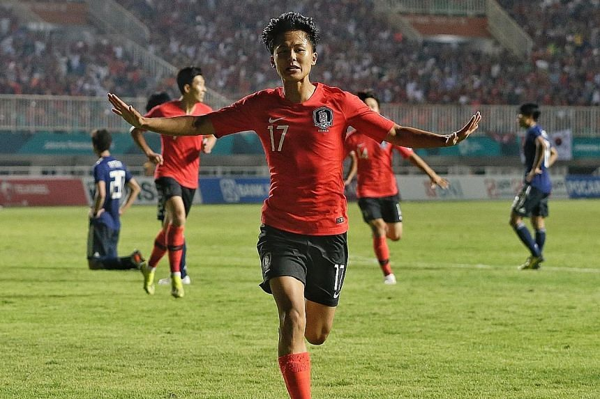 Lee Seung-woo celebrating after opening accounts against Japan in extra time in the final in Bogor yesterday. South Korea won 2-1.