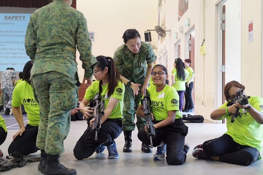 Participants learning how to operate the SAR21 rifle. Athi Ramesh Athirah (second from right), is the youngest participant at 13 years old.