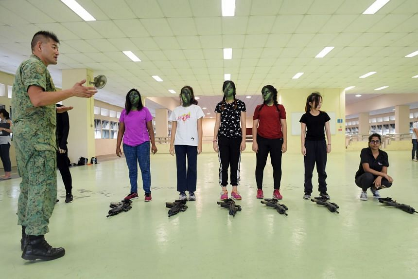 Journalists Farzanah Friday (third from right) and Bridget Tan (fourth from right), as well as other participants, taking part in the inaugural Women's Boot Camp 2018 held at Maju Camp, on Sept 1, 2018.