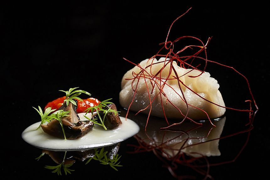 Labyrinth's chef-owner Han Li Guang's Ang Moh Chicken Rice (above) is one of his modern interpretations of local food.