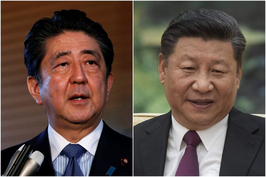 Japanese Prime Minister Shinzo Abe's (left) comments came amid intensifying US trade pressure on Beijing and Tokyo that has raised concerns about protectionism and its impact on the global economy.