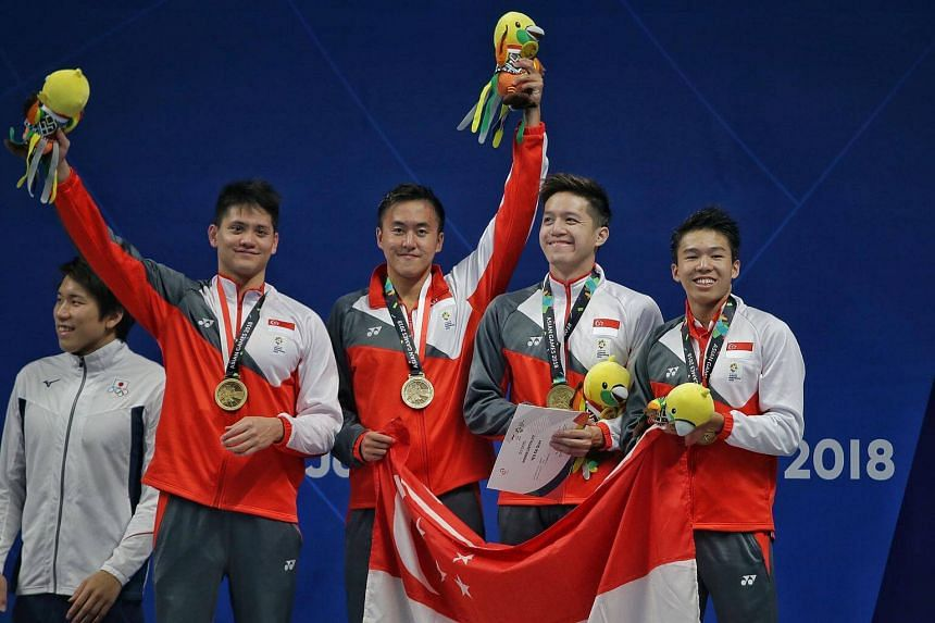 Joseph Schooling (from left), Quah Zheng Wen, Jonathan Tan and Danny Yeo with their bronze medals from the men's 4x200m freestyle relay final at the 18th Asian Games in Gelora Bung Karno Aquatic Centre, Jakarta, on Aug 20, 2018.