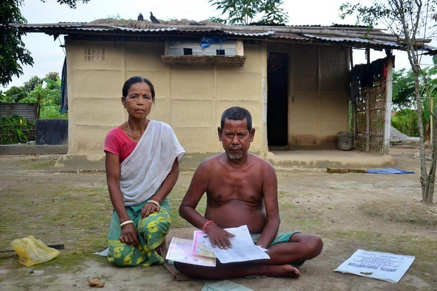 Nimai Hajong and his wife Sinibala Hajong sitting in front of their house in Bamunigaon village in Assam's Kamrup district, on Aug 8, 2018. The 58-year-old has been declared a foreigner despite living in the area for the past 5 decades.