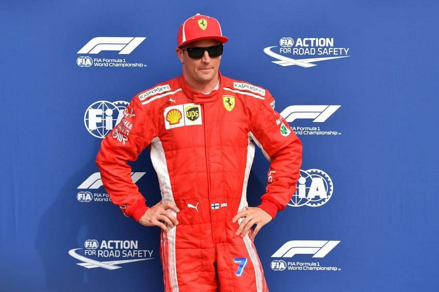 Ferrari's Finnish driver Kimi Raikkonen celebrates winning the pole position after the qualifying session at the Autodromo Nazionale circuit in Monza, on Sept 1, 2018.