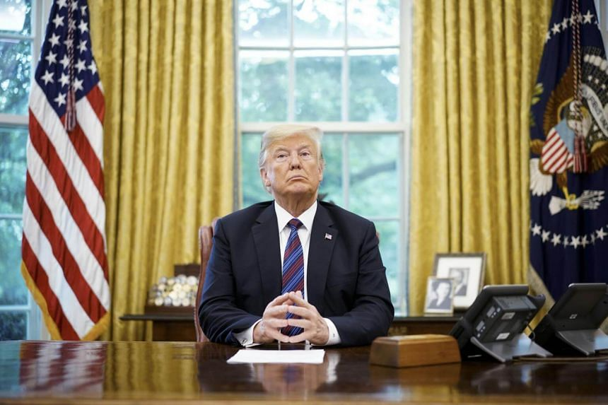 US President Donald Trump listens during a phone conversation with Mexico's President Enrique Pena Nieto on trade in the Oval Office of the White House in Washington, on Aug 27, 2018.