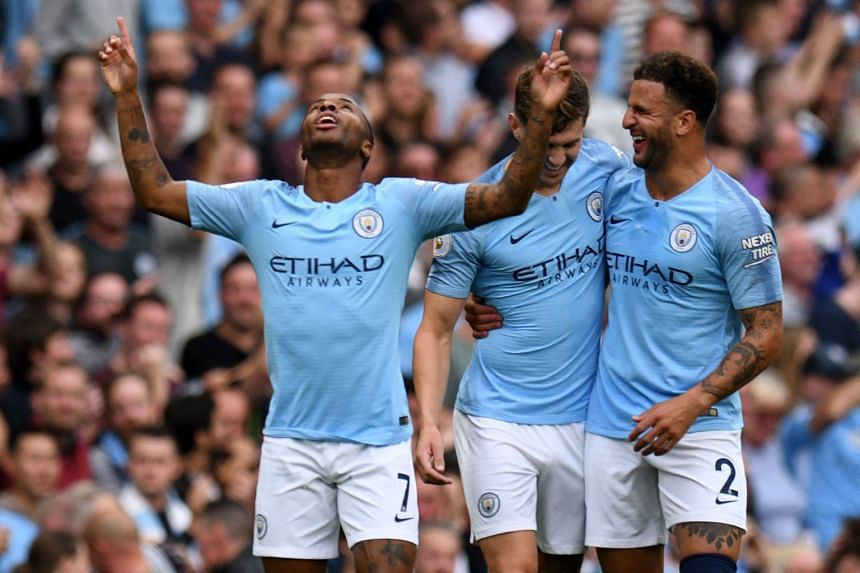 City's Sterling (left) celebrates after scoring the opening goal.
