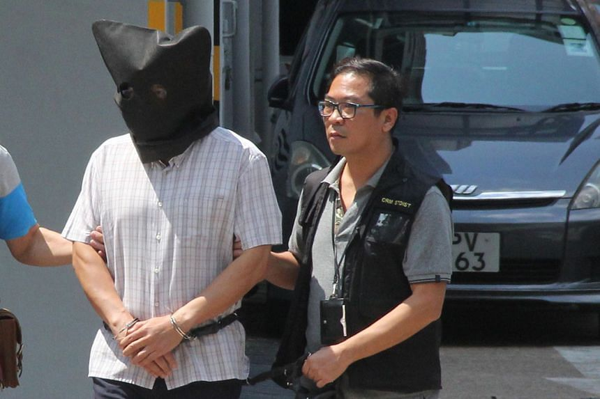 Khaw Kim Sun (above) is accused of killing his wife Wong Siew Fing and daughter Lily Khaw Li Ling, both of whom died of carbon monoxide poisoning in their car. A deflated yoga ball (top) was found in the car boot. Photojournalists trying to get a pic