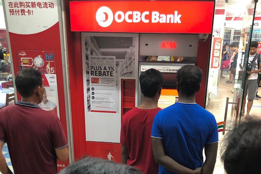 Queues started forming at this OCBC ATM in Lorong 4 Toa Payoh last night because of the service outage