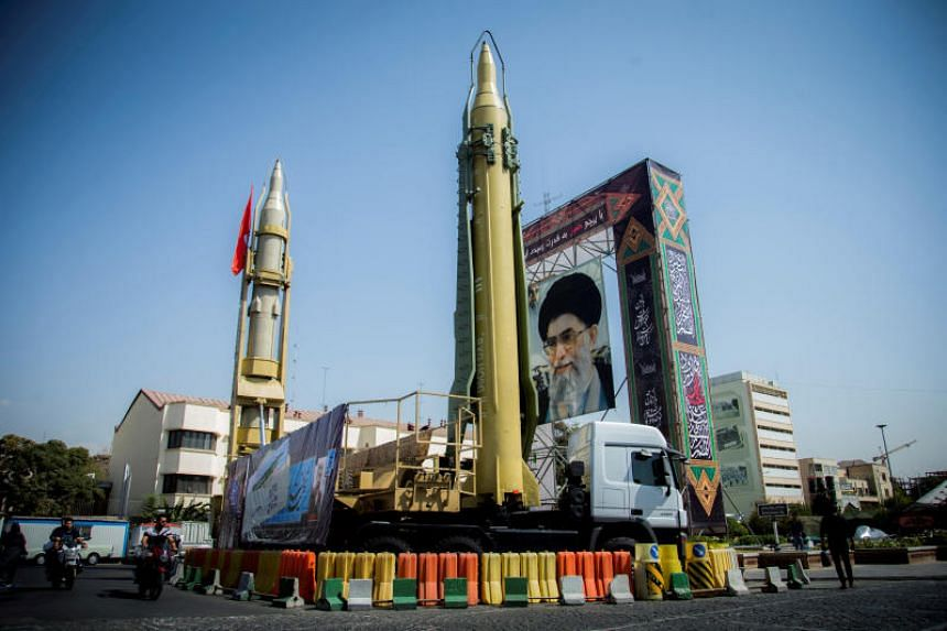 A display featuring missiles and a portrait of Iran's Supreme Leader Ayatollah Ali Khamenei is seen at Baharestan Square in Tehran, Iran, on Sept 27, 2017.