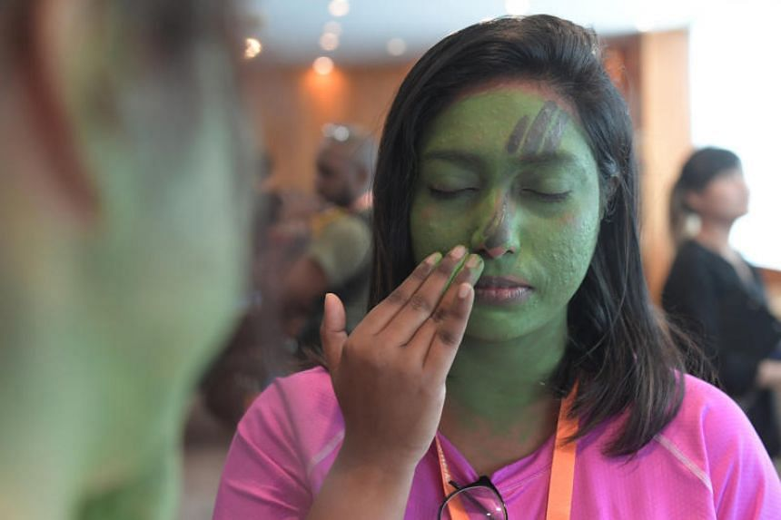 TM journalist Vaidhegi Arumugam, 25, experiences what it is like to apply camouflage cream on her face.