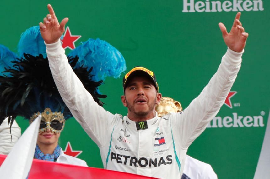 Mercedes' Lewis Hamilton celebrates on the podium after winning the race at the Circuit of Monza, Monza, Italy, on Sept 2, 2018.