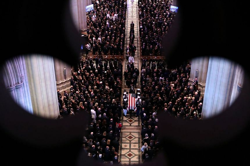 The casket is led out following the funeral service for Senator John McCain.