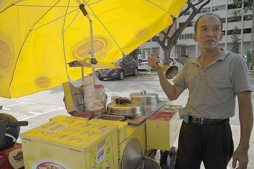 Mr Chua Kheng Lee at work with his motorbike cart. He serves ice cream in the traditional ways, such as wrapped in bread, or sandwiched between two wafers, in addition to the standard wafer cone.