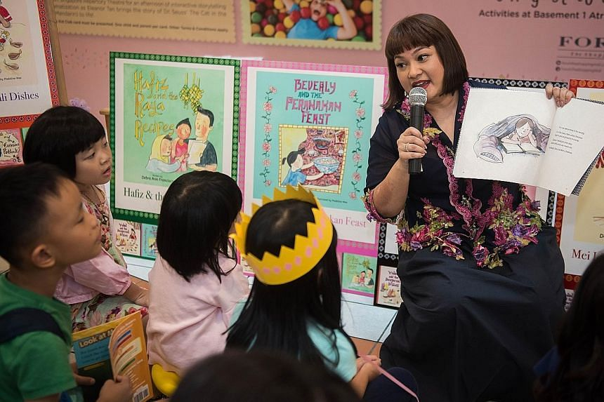Ms Debra Ann Francisco during the reading session at her book launch at Forum the Shopping Mall last Saturday. The former teacher hopes her books will find their way into the homes of Singaporean families living here and overseas.