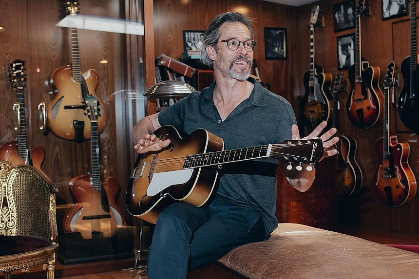 Guy Pearce, who is starring in Netflix series The Innocents, plays a guitar at Rudy's Music in Soho, New York.