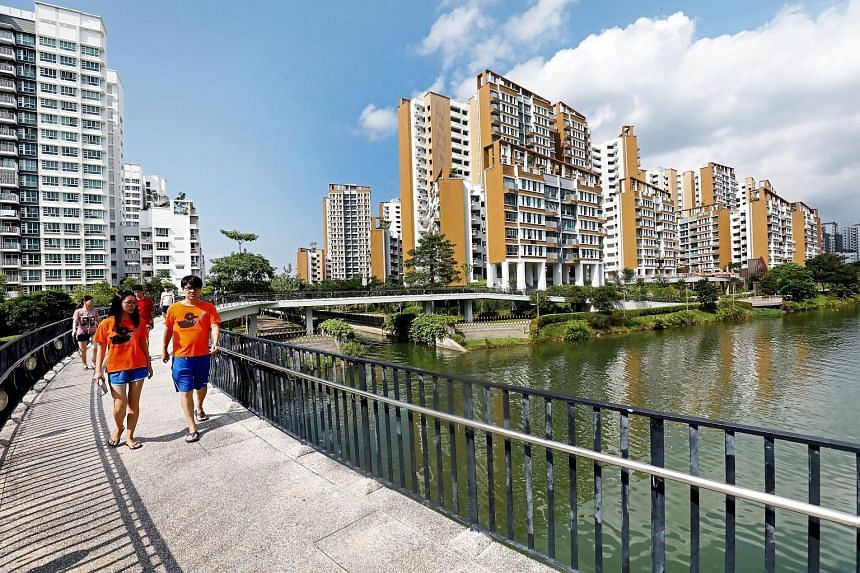 """The Waterway View project in Punggol harks back to the estate's beginnings as a """"kelong"""" or fishing village with features such as a textured facade that mimics wood for the 10 blocks, which are also staggered to allow as many of their residents as po"""