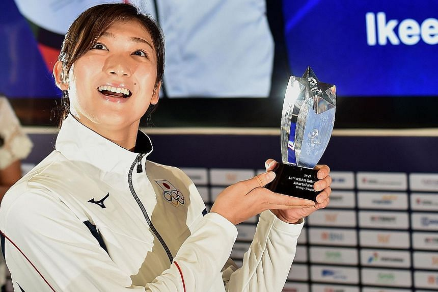 Japanese swimmer Rikako Ikee with her Most Valuable Player trophy in Jakarta after being named the best athlete at the Asian Games. The 18-year-old was given the award after becoming the first woman to win six gold medals at a single Asiad.