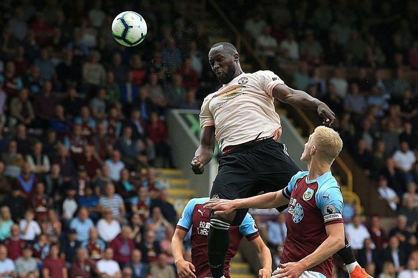 Manchester United striker Romelu Lukaku rising unopposed to head home the first of his two goals against Burnley. United's 2-0 win at Turf Moor halted a two-match losing run but left the home side with just one point from their first four Premier Lea