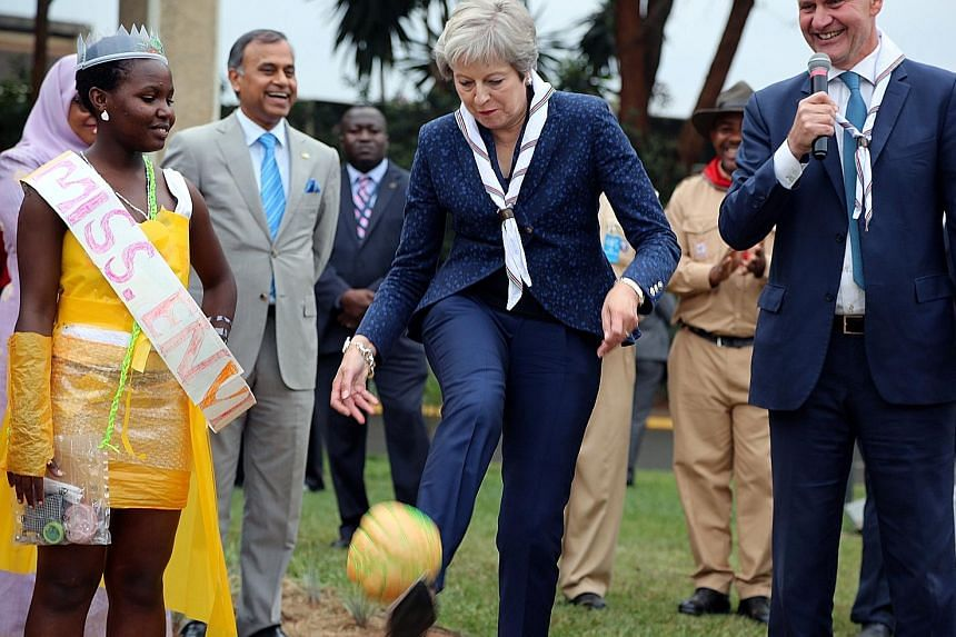 British Prime Minister Theresa May kicking a ball made of recycled plastic on her visit to the United Nations complex in Nairobi last week.