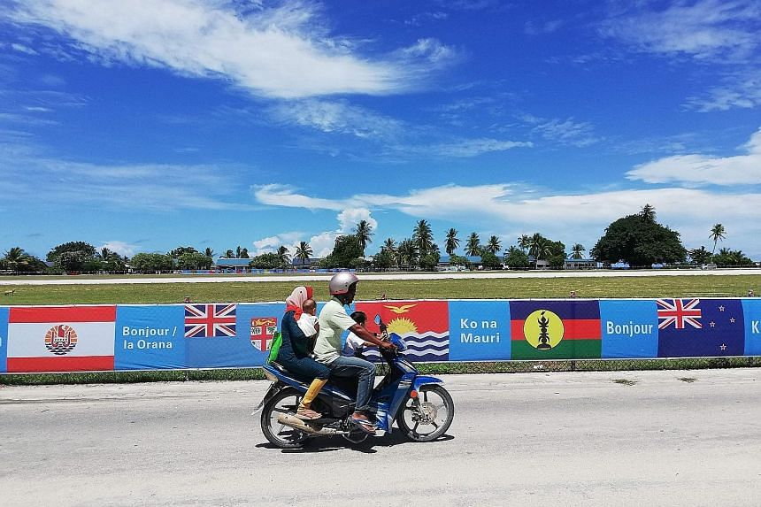 Ahead of the 18-nation Pacific Islands Forum, national flags are seen lining a road in Yaren on Nauru. The four-day meet opens today.