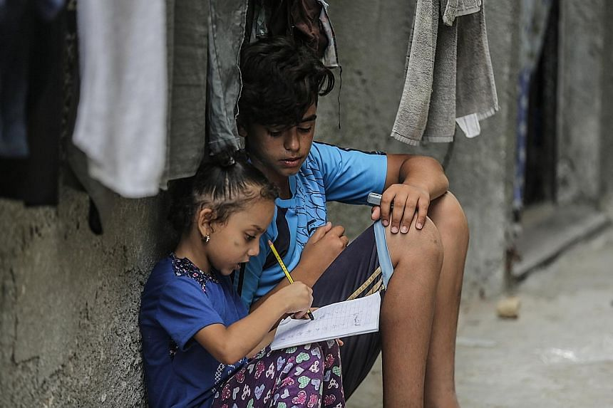 Palestinian refugee children in Gaza City. The US has ended all funding to the United Nations Relief and Works Agency for Palestine Refugees in the Near East. Among other things, the agency provides schooling to 526,000 children in the Palestinian te