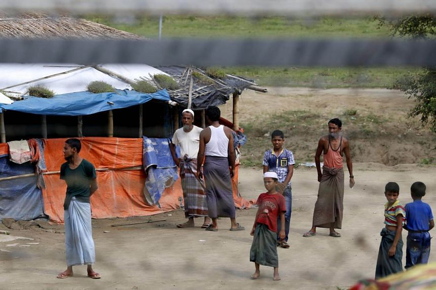 Rohingya refugees stand near a makeshift house at an area between the Bangladesh-Myanmar border in Maungdaw district, Rakhine State, western Myanmar, on Aug 24, 2018.