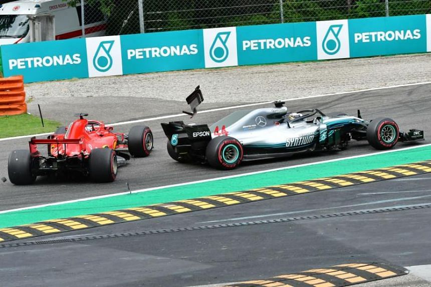 Car parts fly as Mercedes' British driver Lewis Hamilton (right) and Ferrari's German driver Sebastian Vettel crash during the Italian Formula One Grand Prix at the Autodromo Nazionale circuit in Monza, on Sept 2, 2018.