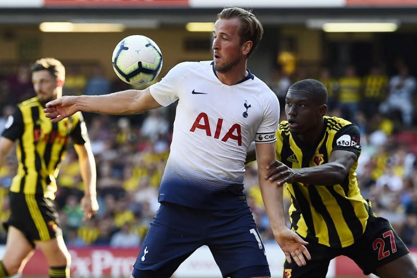 Watford's Christian Kabasele (right) vies for the ball against Tottenham Hotspur's Harry Kane during the EPL match between Watford and Tottenham Hotspur at Vicarage Road, Watford, London, Britain, on Sept 2, 2018.