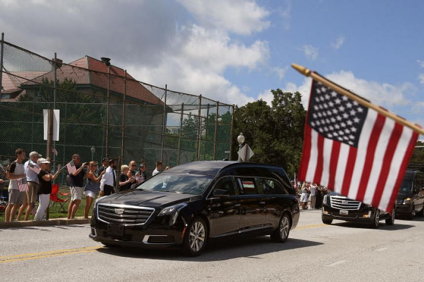 A hearse containing the body of the late Senator John McCain arrives for a private memorial service and burial at the US Naval Academy in Annapolis, US, on Sept 2, 2018.