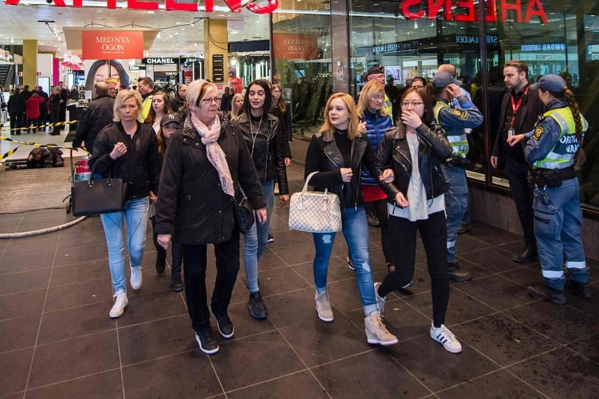 People outside a department store in Stockholm, on April 10, 2017. Sweden has the fifth-highest life expectancy in Europe, and cancer survival rates are among the continent's highest.
