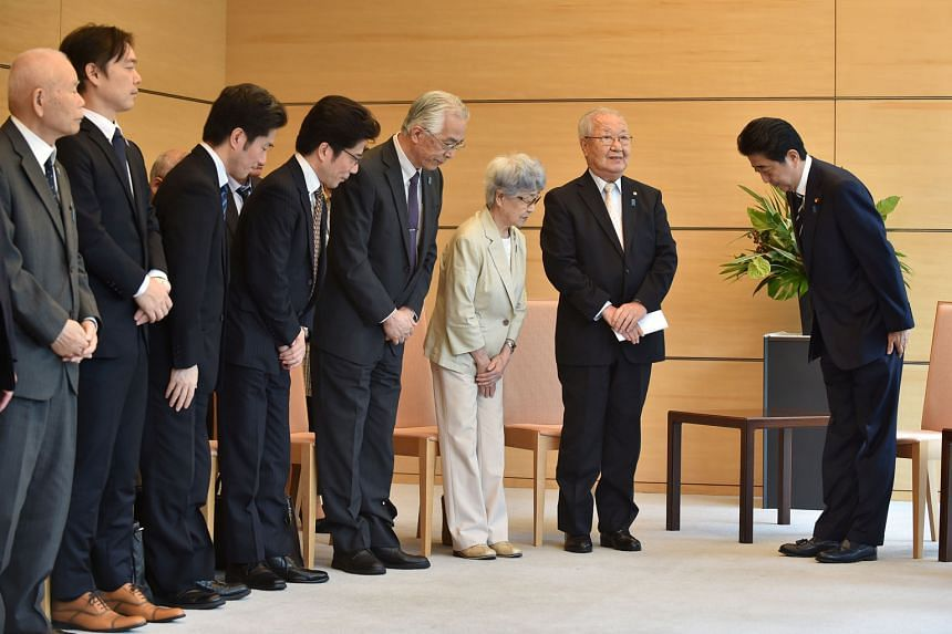Japan's Prime Minister Shinzo Abe meeting family members of victims abducted by North Korea in the 1970s and 1980s, at the Prime Minister's official residence in Tokyo on June 14.