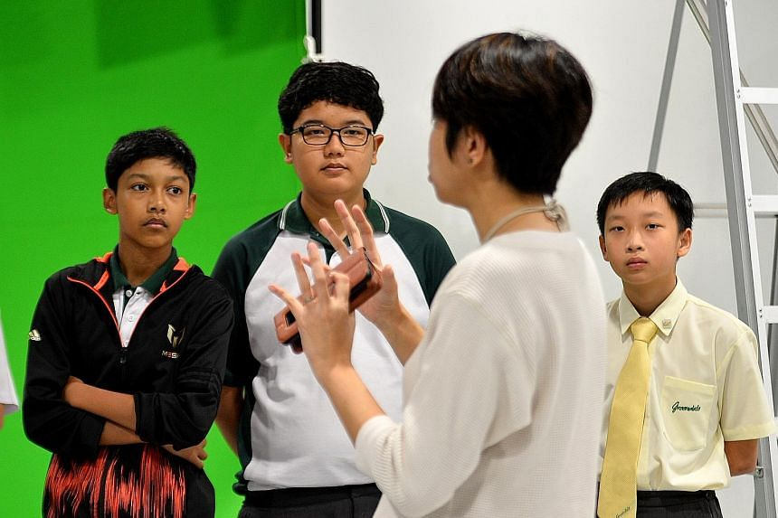 Greendale Secondary School students (from left) Feroz Khan Abdul Rahman, Irfan Yusry Iszreen and Albert Loh, on a tour of Pixel Building in Buona Vista, as part of the annual N.E.mation contest.