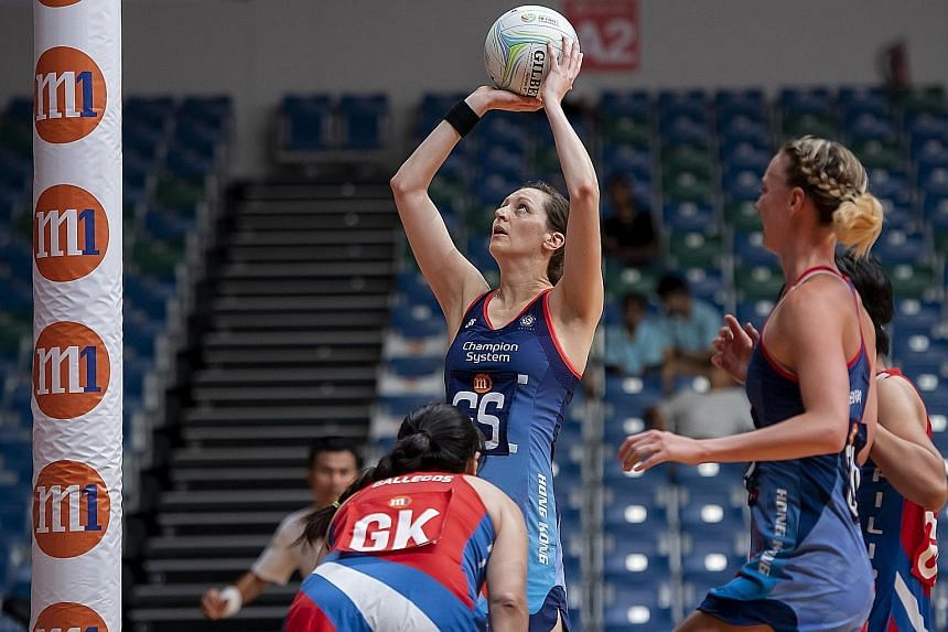 Goal-shooter Krystle Edwards attempting to score as Hong Kong beat the Philippines 73-15 in their final Pool D game at the OCBC Arena yesterday to qualify for the M1 Asian Netball Championship Cup group, alongside Singapore, Malaysia and Sri Lanka. T