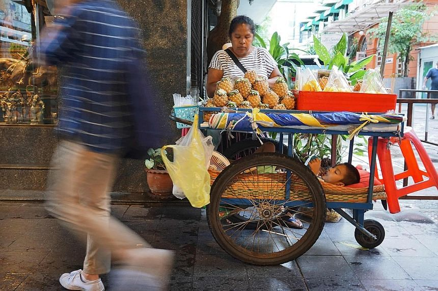 A fruit vendor in Bangkok. Rising food and energy costs in Thailand boosted inflation to 1.6 per cent last month, the highest in almost four years, adding to the case for the Bank of Thailand to deliver its first rate hike since 2011. The policy rate