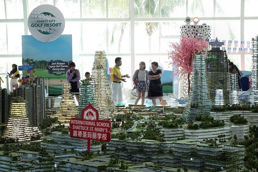 Visitors to Country Gardens' Forest City showroom in Johor last week. Johor housing and rural development committee chairman Dzulkefly Ahmad, a member of the Johor state Cabinet, said in a news report that the proposed quota for Malaysians was based