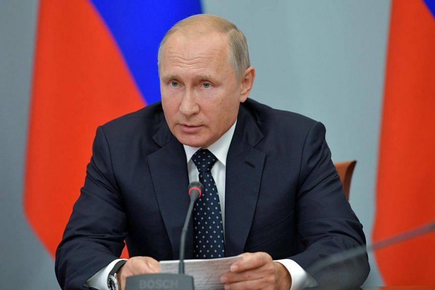Russia's President Vladimir Putin chairs a government meeting on social and economic issues in the Siberian city of Omsk, Russia, on Aug 28, 2018.