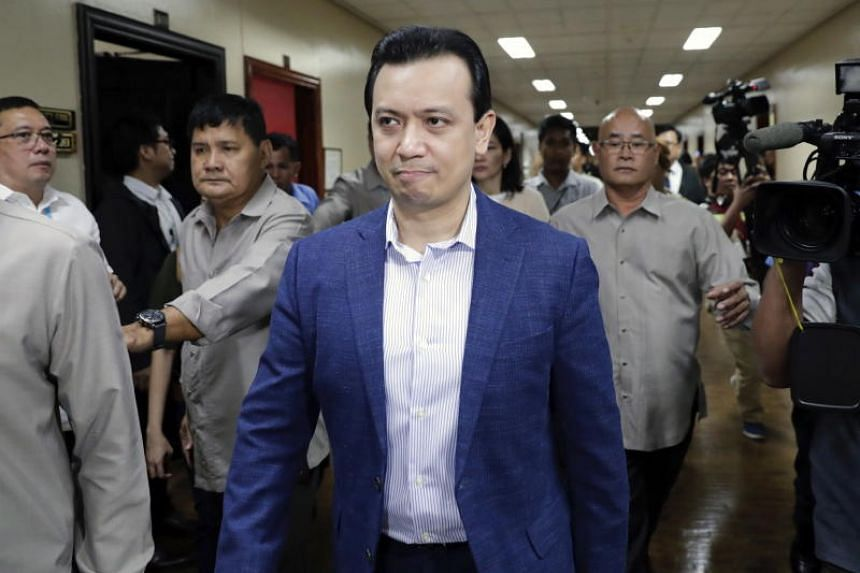 Philippine Senator Antonio Trillanes IV (centre), a former military mutiny leader, walks back to his office at the Philippine Senate in Manila, on Sept 4, 2018.