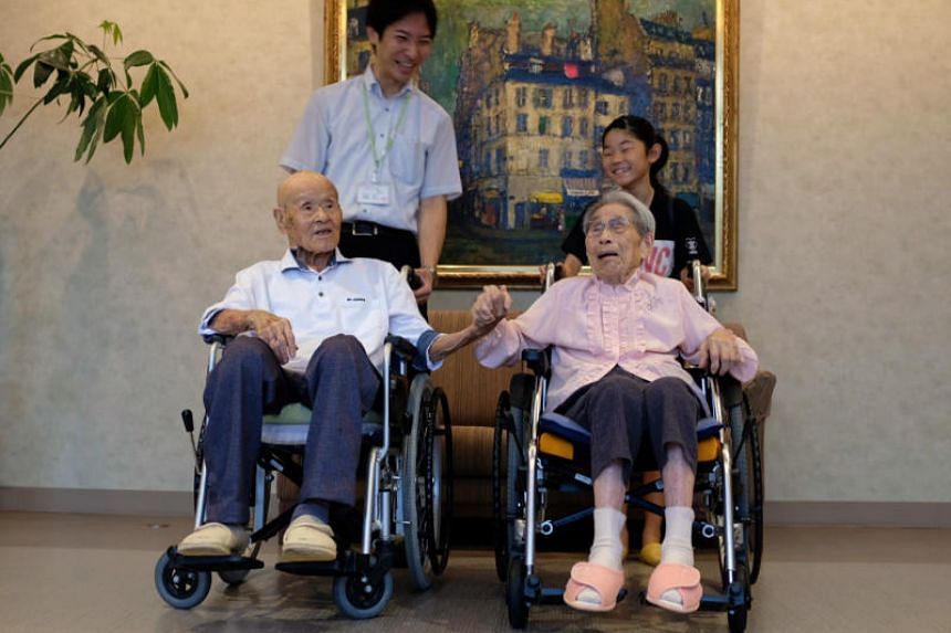 World's oldest living married couple Masao Matsumoto and Miyako Matsumoto pose for a photo with their great-grandchild and their care staff at a nursing house in Takamatsu, Kagawa prefecture, on Sept 4, 2018.
