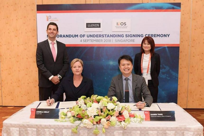 Lloyd's Asia country manager Angela Kelly and Ipos chief executive Daren Tang sign a memorandum of understanding during IP Week @ SG 2018 on Sept 4, 2018.
