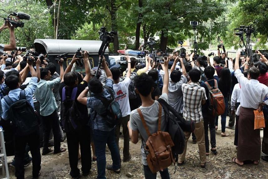 Myanmar reporters take pictures as police escort away Reuters journalists Wa Lone and Kyaw Soe Oo after being sentenced by a court to seven years jail in Yangon for breaching Myanmar's official secrets act, on Sept 3, 2018.