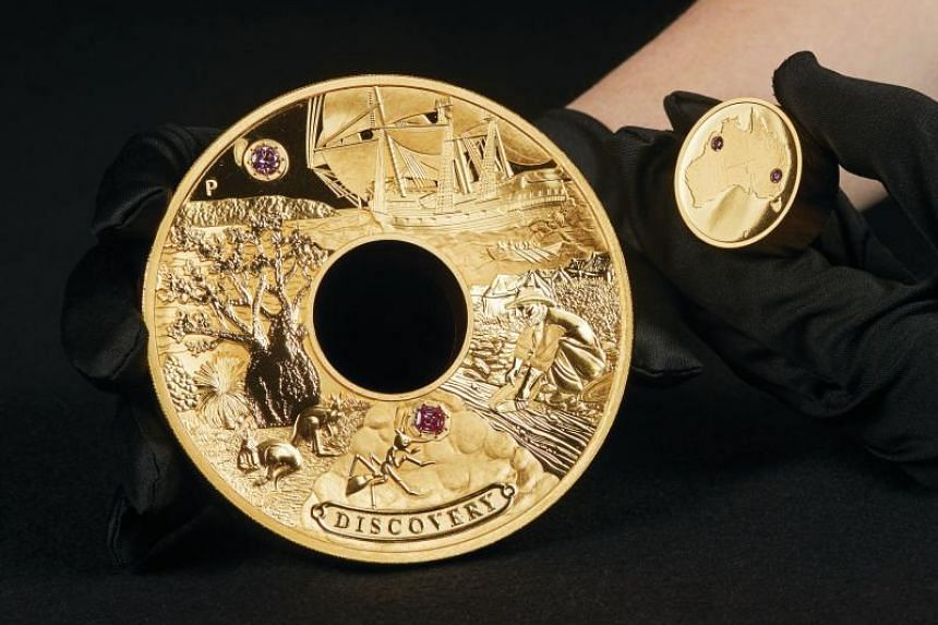 The 2kg gold coin is encrusted with rare pink diamonds worth A$2.48 million (S$2.45 million).